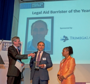 Marc Willers receiving his award from Doreen Lawrence and John Howard